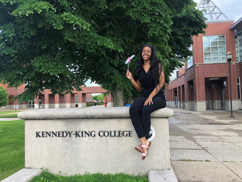Student sitting in front of Kennedy-King College